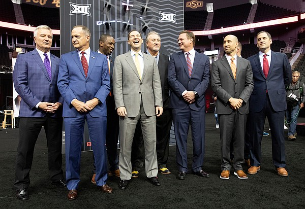 Kansas head coach Bill Self and other Big 12 coaches assemble for a group photos during Big 12 Media Day on Wednesday, Oct. 23, 2019 at Sprint Center in Kansas City.