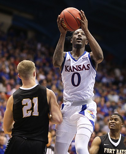 Kansas guard Marcus Garrett (0) floats in for a bucket over Fort Hays State forward Jared Vitztum (21) during the second half, Thursday, Oct. 24, 2019 at Allen Fieldhouse.