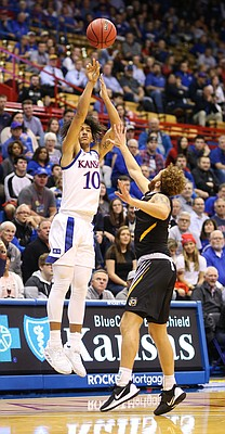 Kansas forward Jalen Wilson (10) puts up a three from the wing during the second half, Thursday, Oct. 24, 2019 at Allen Fieldhouse.
