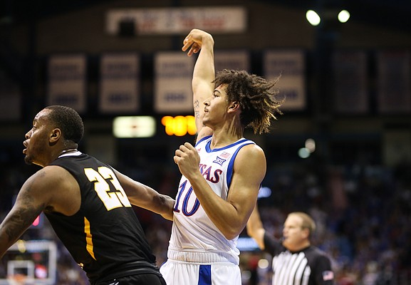 Kansas forward Jalen Wilson (10) hangs up his arm after putting up a three over Fort Hays State guard Calvin Harrington (23) during the first half, Thursday, Oct. 24, 2019 at Allen Fieldhouse.