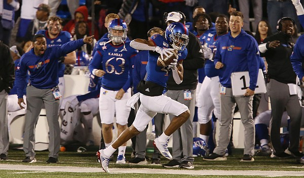 Kansas wide receiver Andrew Parchment (4) runs close along the sidelines after a catch and rans for a second-half touchdown in the Jayhawks 37-34 in Saturday.