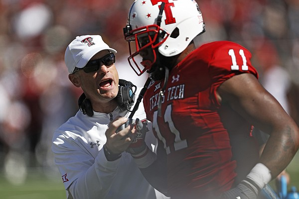 Texas Tech coach Matt Wells talks to Donta Thompson (11) during the second half of an NCAA college football game against Iowa State, Saturday, Oct. 19, 2019, in Lubbock, Texas. (Brad Tollefson/Lubbock Avalanche-Journal via AP)
