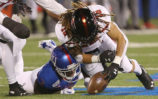 Kansas wide receiver Andrew Parchment (4) loses the ball on an incomplete pass play in the first half of Saturday's game against Texas Tech at David Booth Memorial Stadium.