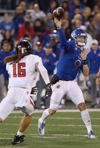 Kansas quarterback Carter Stanley (9) passes during the Kansas-Texas Tech game Saturday at David Booth Kansas Memorial Stadium.
