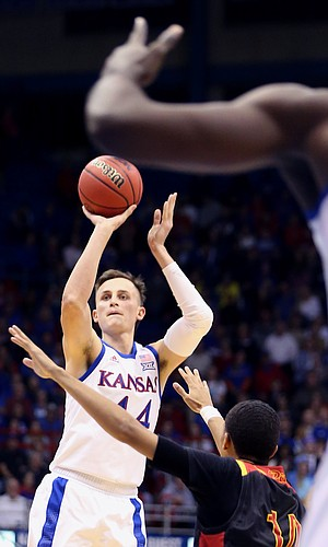 Kansas forward Mitch Lightfoot (44) launches a three-point shot during the second half of KU's win against Pittsburg State Thursday at Allen Fieldhouse.