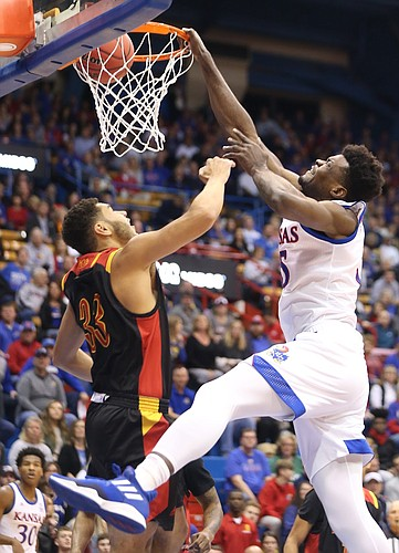 Kansas center Udoka Azubuike (35) dunks over Pittsburg State forward Christian Edmonson (33) during the first half, Thursday, Oct. 31, 2019 at Allen Fieldhouse.