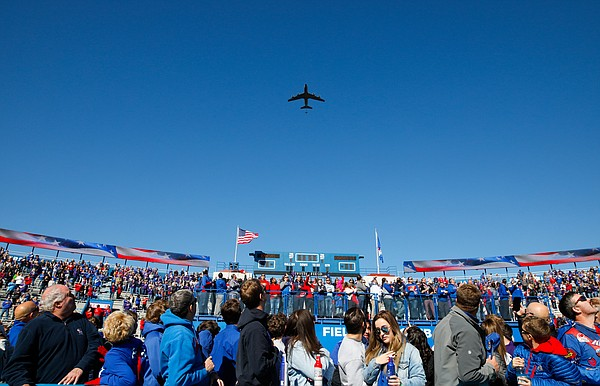 Fans watch as an air refueled flies over Memorial Stadium prior to kickoff on Saturday, Nov. 2, 2019 at Memorial Stadium.