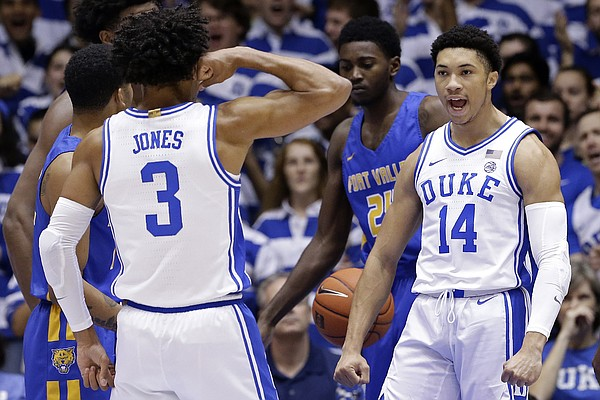 Duke guard Tre Jones (3) and guard Jordan Goldwire (14) react following a play against Fort Valley State during the first half of an NCAA exhibition college basketball game in Durham, N.C., Wednesday, Oct. 30, 2019. (AP Photo/Gerry Broome)