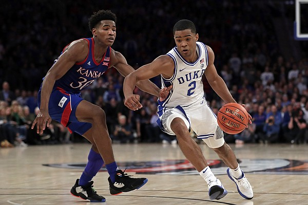 Duke guard Cassius Stanley (2) drives to the basket past Kansas guard Ochai Agbaji (30) during the second half of an NCAA college basketball game Tuesday, Nov. 5, 2019, in New York. (AP Photo/Adam Hunger)