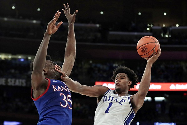Duke center Vernon Carey Jr. (1) shoots as Kansas center Udoka Azubuike (35) defends during the second half of an NCAA college basketball game Tuesday, Nov. 5, 2019, in New York. (AP Photo/Adam Hunger)