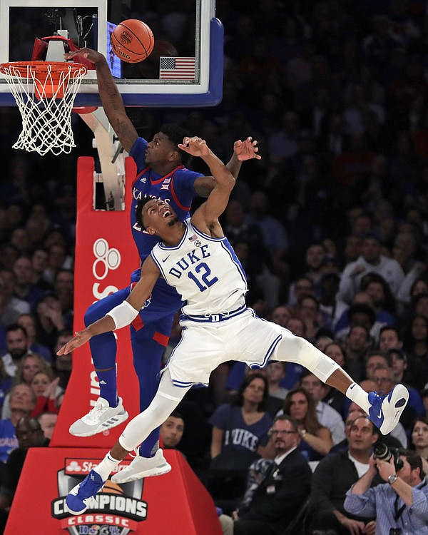 Duke forward Javin DeLaurier (12) defends against Kansas forward Silvio De Sousa, and is called for a foul during the second half of an NCAA college basketball game Tuesday, Nov. 5, 2019, in New York. (AP Photo/Adam Hunger)