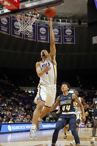 LSU guard Skylar Mays (4) goes to the basket against UNC Greensboro guard Kaleb Hunter (44) in the first half an NCAA college basketball game in Baton Rouge, La., Friday, Nov. 9, 2018. (AP Photo/Gerald Herbert)
