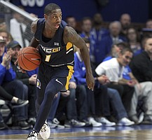 UNC Greensboro's Isaiah Miller looks for an open teammate during the second half of an NCAA college basketball game against Kentucky in Lexington, Ky., Saturday, Dec. 1, 2018. Kentucky won 78-61. (AP Photo/James Crisp)