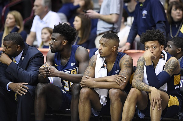 UNC-Greensboro bench reacts as their team loses the lead against Wofford in the second half of an NCAA college basketball game for the Southern Conference tournament championship, Monday, March 11, 2019, in Asheville, N.C. (AP Photo/Kathy Kmonicek)