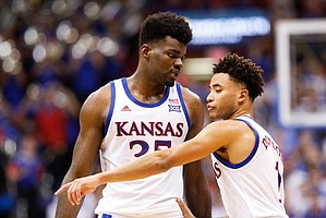 Kansas center Udoka Azubuike (35) and Kansas guard Devon Dotson (1) have a quick meeting on the court after a timeout during the second half, Friday, Nov. 8, 2019 at Allen Fieldhouse.