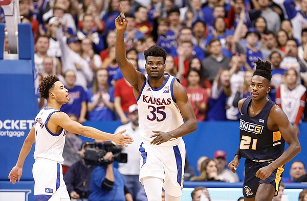 Kansas center Udoka Azubuike (35) signals the ball going the Jayhawks' way as he and Kansas guard Devon Dotson (1) celebrate a UNC-Greensboro turnover during the second half, Friday, Nov. 8, 2019 at Allen Fieldhouse. At right is UNC-Greensboro forward James Dickey (21).