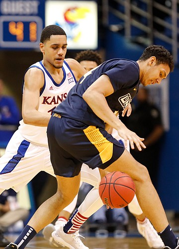 Kansas guard Tristan Enaruna (13) pressures UNC-Greensboro forward Kyrin Galloway (14) during the second half, Friday, Nov. 8, 2019 at Allen Fieldhouse.