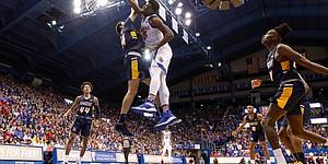 Kansas center Udoka Azubuike (35) throws down a dunk over UNC-Greensboro forward Kyrin Galloway (14) during the second half, Friday, Nov. 8, 2019 at Allen Fieldhouse.