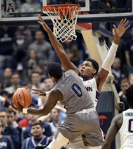 Connecticut's Josh Carlton defends against Monmouth's Ray Salnave in the second half of an NCAA college basketball game Saturday, Dec. 2, 2017, at the XL Center in Hartford, Conn. Connecticut won 84-81. (AP Photo/Stephen Dunn)
