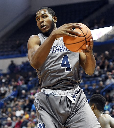 Monmouth's Mustapha Traore grabs a rebound in the second half of an NCAA college basketball game against Connecticut Saturday, Dec. 2, 2017, at the XL Center in Hartford, Conn. Connecticut won in OT, 84-81. (AP Photo/Stephen Dunn)