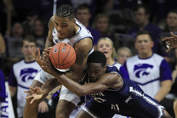 Monmouth forward Nikkei Rutty, right, battles Kansas State forward Levi Stockard III (34) for the ball during the first half of an NCAA college basketball game in Manhattan, Kan., Wednesday, Nov. 13, 2019. (AP Photo/Orlin Wagner)