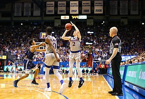 Kansas guard Christian Braun (2) puts up a three from the wing during the first half on Friday, Nov. 15, 2019 at Allen Fieldhouse.