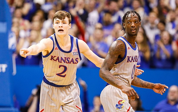 Kansas guard Christian Braun (2) and Kansas guard Marcus Garrett (0) get back on defense during the first half on Friday, Nov. 15, 2019 at Allen Fieldhouse.