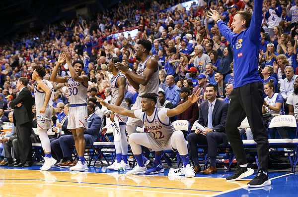 The Kansas bench celebrates a three from walk-on Michael Jankovich during the second half on Friday, Nov. 15, 2019 at Allen Fieldhouse.