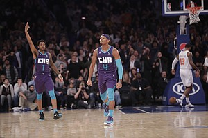 Charlotte Hornets' Devonte' Graham (4) and teammate Malik Monk (1) react after Graham hit the game winning 3-pointer during the second half of an NBA basketball game against the New York Knicks Saturday, Nov. 16, 2019, in New York. The Hornets won 103-102. (AP Photo/Frank Franklin II)