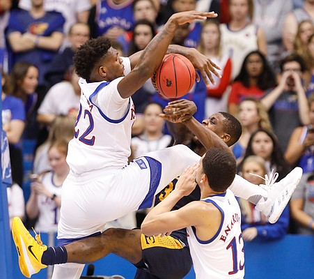 Kansas forward Silvio De Sousa (22) engulfs a shot attempt by East Tennessee State guard Bo Hodges (3) during the second half on Tuesday, Nov. 19, 2019 at Allen Fieldhouse.