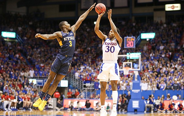 Kansas guard Ochai Agbaji (30) has a shot blocked by East Tennessee State guard Bo Hodges (3) during the first half on Tuesday, Nov. 19, 2019 at Allen Fieldhouse.
