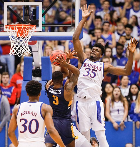 Kansas center Udoka Azubuike (35) elevates to stuff a shot by East Tennessee State guard Bo Hodges (3) during the second half on Tuesday, Nov. 19, 2019 at Allen Fieldhouse.