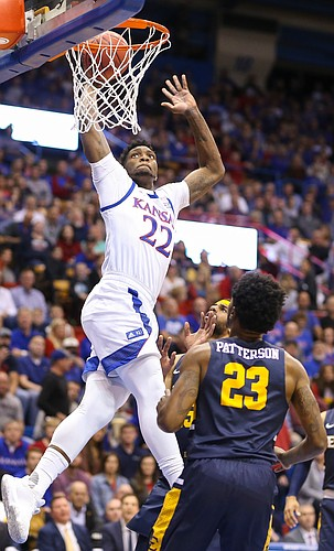 Kansas forward Silvio De Sousa (22) comes in for a jam off a lob from Kansas guard Devon Dotson (1) during the first half on Tuesday, Nov. 19, 2019 at Allen Fieldhouse.