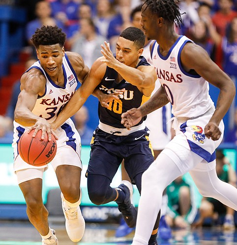 Kansas guard Ochai Agbaji (30) comes away with a ball from East Tennessee State guard Patrick Good (10) after it was poked loose by Kansas guard Marcus Garrett (0) during the second half on Tuesday, Nov. 19, 2019 at Allen Fieldhouse.