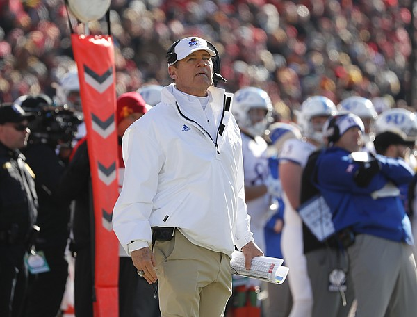 Kansas head coach Les Miles watches from the sidelines during the first half of an NCAA college football game against Iowa State, Saturday, Nov. 23, 2019, in Ames, Iowa. (AP Photo/Matthew Putney)