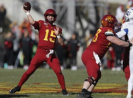 Iowa State quarterback Brock Purdy drops back to pass during the first half of an NCAA college football game against Kansas, Saturday, Nov. 23, 2019, in Ames, Iowa. (AP Photo/Matthew Putney)