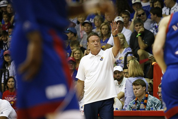 Kansas head coach Bill Self signals to his team during an NCAA college basketball game against Chaminade, Monday, Nov. 25, 2019, in Lahaina, Hawaii. (AP Photo/Marco Garcia)