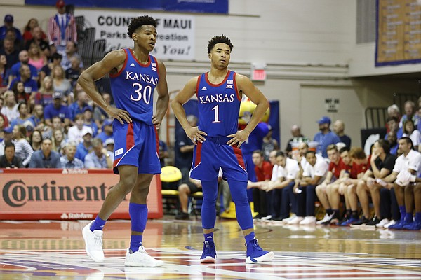 Kansas guard Ochai Agbaji (30) and guard Devon Dotson (1) are seen on the court during an NCAA college basketball game against Chaminade Monday, Nov. 25, 2019, in Lahaina, Hawaii. (AP Photo/Marco Garcia)