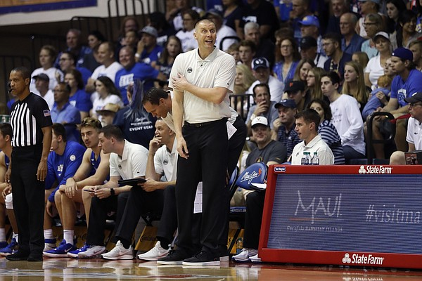BYU head coach Mark Pope reacts on the sideline during the first half of an NCAA college basketball game against UCLA, Monday, Nov. 25, 2019, in Lahaina, Hawaii. (AP Photo/Marco Garcia)