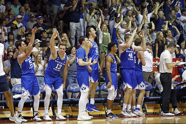 The BYU bench reacts to the team scoring a 3-point play against UCLA during the second half of an NCAA college basketball game, Monday, Nov. 25, 2019, in Lahaina, Hawaii. (AP Photo/Marco Garcia)