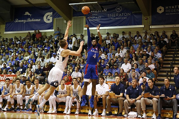 Kansas guard Isaiah Moss (4) attempts a three point shot over BYU guard Jake Toolson (5) during the first half of an NCAA college basketball game Tuesday, Nov. 26, 2019, in Lahaina, Hawaii. (AP Photo/Marco Garcia)