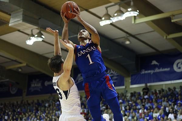 Kansas guard Devon Dotson (1) shoots over BYU forward Dalton Nixon (33) during the first half of an NCAA college basketball game, Tuesday, Nov. 26, 2019, in Lahaina, Hawaii. (AP Photo/Marco Garcia)