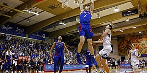Kansas guard Christian Braun (2) dunks against BYU during the second half of an NCAA college basketball game, Tuesday, Nov. 26, 2019, in Lahaina, Hawaii. (AP Photo/Marco Garcia)