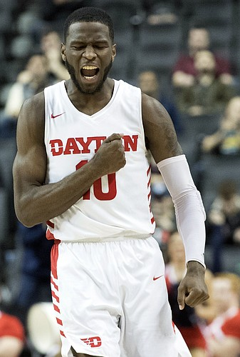 Dayton guard Jalen Crutcher reacts after scoring a 3-point basket during the second half of an NCAA college basketball game against the Saint Louis in the Atlantic 10 Conference tournament, Friday, March 15, 2019, in New York. Saint Louis won 64-55. (AP Photo/Mary Altaffer)