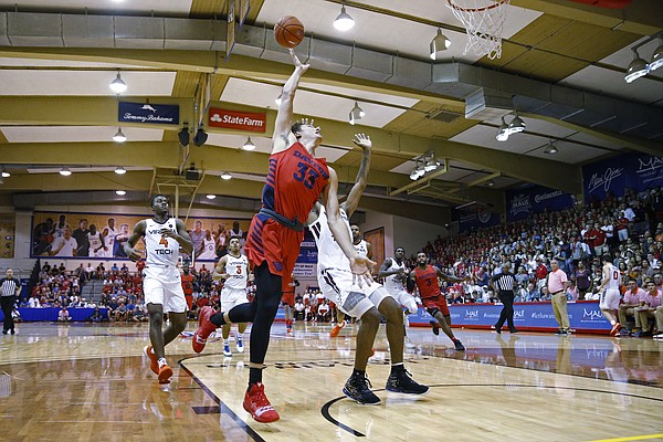 Dayton forward Ryan Mikesell (33) gets fouled as he makes a basket over Virginia Tech during the first half of an NCAA college basketball game Tuesday, Nov. 26, 2019, in Lahaina, Hawaii. (AP Photo/Marco Garcia)