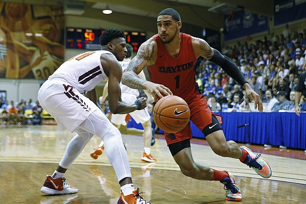 Dayton forward Obi Toppin (1) gets around Virginia Tech forward John Ojiako (21) during the second half of an NCAA college basketball game Tuesday, Nov. 26, 2019, in Lahaina, Hawaii. (AP Photo/Marco Garcia)\