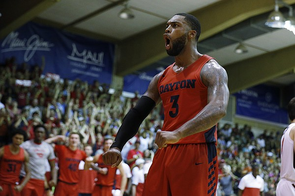 Dayton guard Trey Landers (3) reacts after slam dunking the ball over Virginia Tech during the second half of an NCAA college basketball game Tuesday, Nov. 26, 2019, in Lahaina, Hawaii. (AP Photo/Marco Garcia)