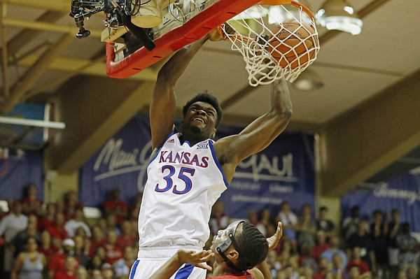 Kansas center Udoka Azubuike (35) dunks the ball over Dayton guard Rodney Chatman (0) during the first half of an NCAA college basketball game Wednesday, Nov. 27, 2019, in Lahaina, Hawaii. (AP Photo/Marco Garcia)