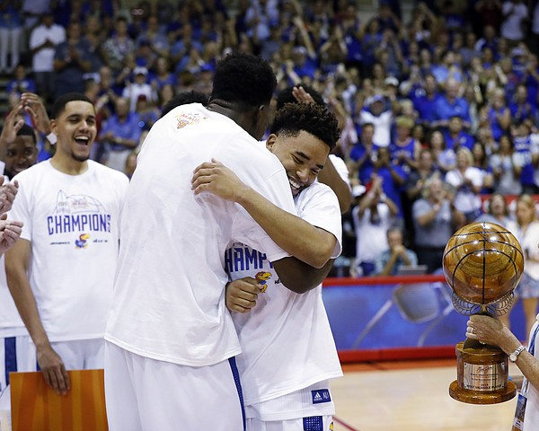 Kansas center Udoka Azubuike, left, and Kansas guard Devon Dotson react after winning co-MVP of the tournament, Wednesday, Nov. 27, 2019, in Lahaina, Hawaii. Kansas defeated Dayton in 90-84 in overtime. (AP Photo/Marco Garcia)