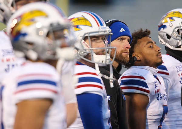 Kansas offensive coordinator Brent Dearmon watches a replay on the video board during the third quarter on Saturday, Nov. 30, 2019 at Memorial Stadium.